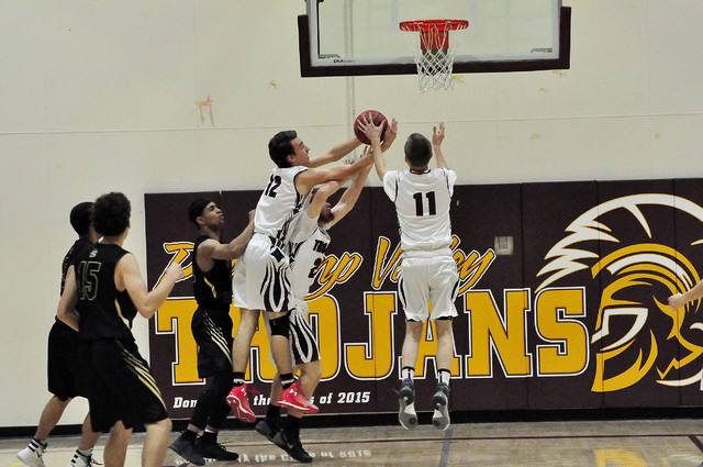 Trojans Boys basketball vs. Spring Valley last year. The boys have not won a league game since Jan. 21, 2014, but this could be the year if they get more guys to come out for the team.  Horace Lan ...