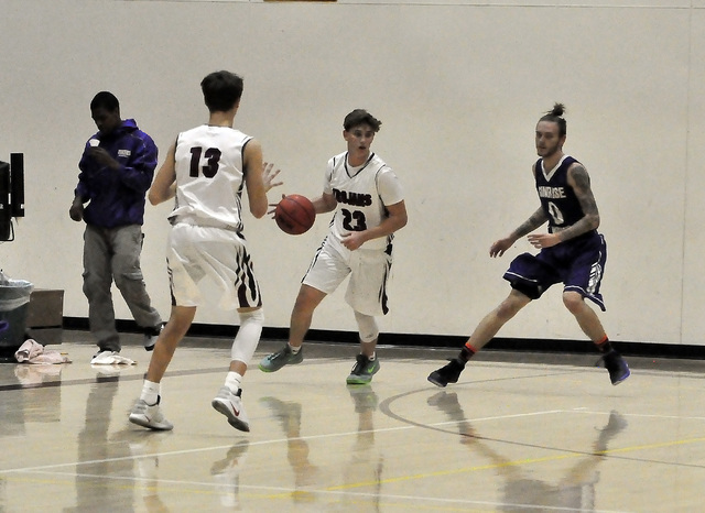 Parker Hart drives the ball toward the key in the first half, when he was just getting warmed up. He sank seven points in the fourth quarter against the Miners on Tuesday.  Horace Langford Jr. / P ...