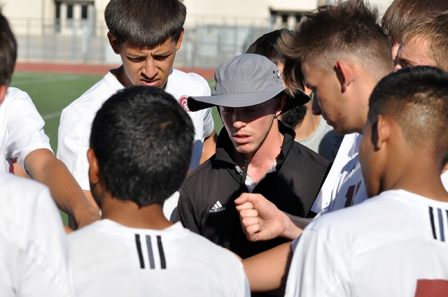 Horace Langford Jr. / Pahrump Valley Times  Trojans gather at the half, with score 1-0 Diamondbacks. Icard told his players to communicate better.