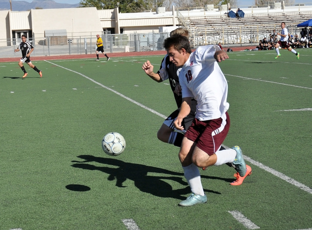 Horace Langford Jr. / Pahrump Valley Times  Senior Paul Holmes takes the ball from a Desert Oasis player on Wednesday.