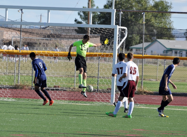 Horace Langford Jr. / Pahrump Valley Times  Pahrump goalkeeper, Nick Harris had an amazing save with his feet against Cheyenne as the Trojans walk off with a win.