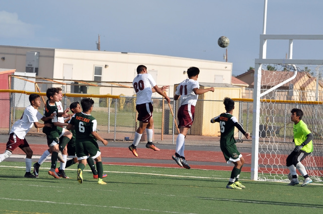 Horace Langford Jr. / Pahrump Valley Times   Jose Pelayo (#20) goes up for the header on a corner kick. On the play he heads the ball to the ground in front of the goal and kicks the ball into the ...