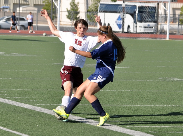 Horace Langford Jr. / Pahrump Valley Times Trojans defender, Tristyn Wombaker, goes one-on-one with a Lions forward last Thursday.