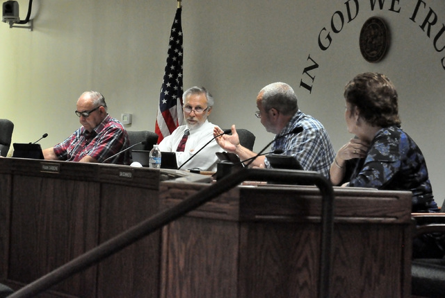 Horace Langford Jr. / Pahrump Valley Times - County Commission meeting Tuesday, Commissioners Butch Borasky, Frank Carbone, Dan Schinhoffen and Donna Cox.