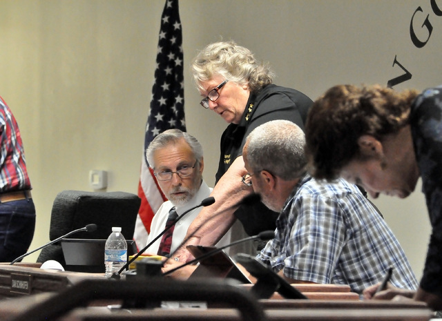 Horace Langford Jr. / Pahrump Valley Times - Nye County Commissioners Frank Carbone and Dan Schinhofen talk to Nye County Sheriff Sharon Wehrly during last commission meeting. Commissioners approv ...