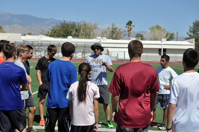 Trojans cross-country coach Matt Kolodzieczyk, talks to his team before practice. This year he is certain his team will go to state barring injury.  Horace Langford Jr. / Pahrump Valley Times