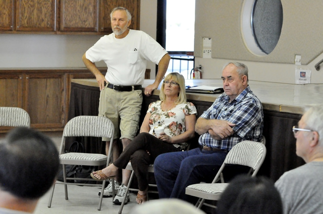 Horace Langford Jr. / Pahrump Valley Times - Nye County Commissioner Frank Carbone, District Attorney Angela Bello and Commissioner Butch Borasky attend the coffee and doughnuts with commissioners ...
