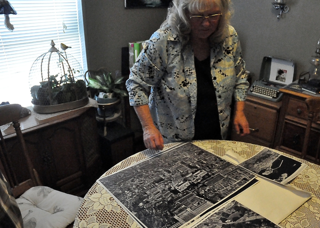 Carol Eberflus, wife of Frank Eberflus Jr., shows off one of the family aerial shots taken by Frank Eberflus Sr. during World War II. Eberflus Sr. had to be strapped to a plane wing to take the ph ...