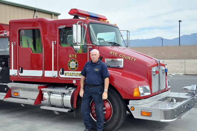 Fire Chief Rich Flanagan of Station 51 of Nye County Emergency Services Technical Response stands in front of their large pumper truck. This is one of five trucks that this 20-man company of firef ...