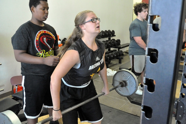 Horace Langford Jr / Pahrump Valley Times  Deja Jackson hits the weight room with the other football players, who really could careless if she plays or not.
