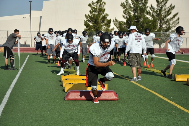 The Trojans football team prepares for full contact during the Southern Utah University football camp in June. The new full contact mandate will not affect the Trojans.  Horace Langford Jr. / Pahr ...