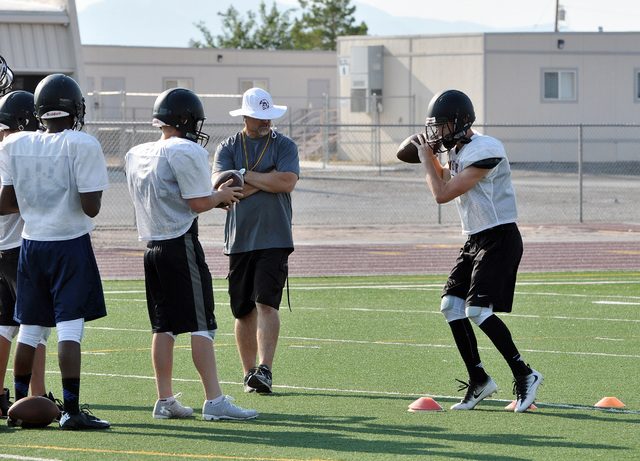 Horace Langford Jr. / Pahrump Valley Times   Trojans quarterbacks practice with coach Joe Clayton. Clayton said senior Parker Hart and junior Dylan Coffman will be competing for the varsity QB pos ...