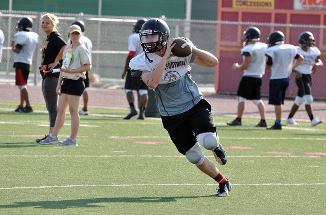"""Horace Langford Jr / Pahrump Valley Times Parker Hart taking reps at the summer football camp. Hart was a junior varsity quarterback, where he ran Clayton's """"jet sweep."""""""