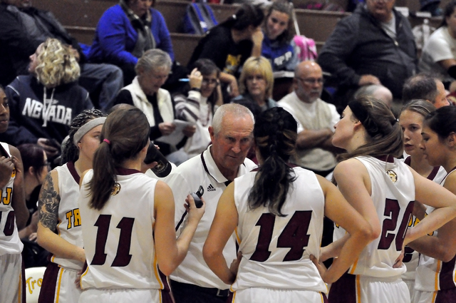 Trojans coach Bob Hopkins tries to rally his troops late in the third quarter. The girls were outscored by the Pirates 16-2 that quarter.  Horace Langford Jr. / Pahrump Valley Times