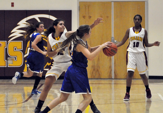 Horace Langford Jr. / Pahrump Valley Times -  Isabelle Meza goes for a steal at the first game of the season. Come out and support the Trojans tonight at 5 p.m. for the girls game and 6:30 p.m. fo ...