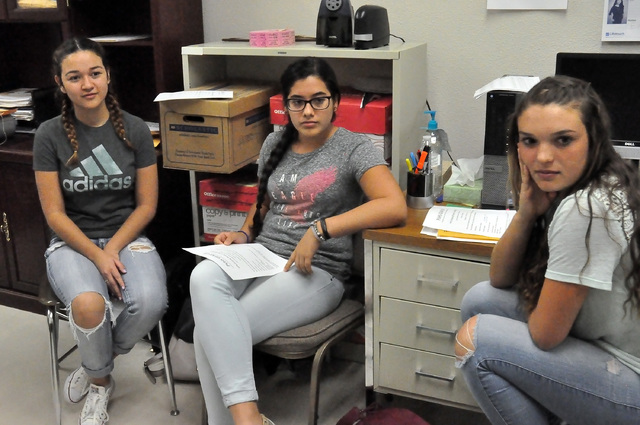 Horace Langford Jr. / Pahrump Valley Times  From left to right, Cassandra Goodman , Ana Valero , and Halie Souza discuss the upcoming Gear Up canned food drive this Friday at the homecoming footba ...