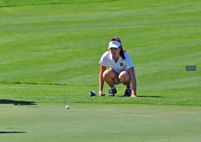 Horace Langford Jr. / Pahrump Valley Times   Makalea Petrie eyeballs a putt at Mountain Falls at the last Sunset Match of the season. Petrie was the best girls golfer at state for the Trojans golf ...