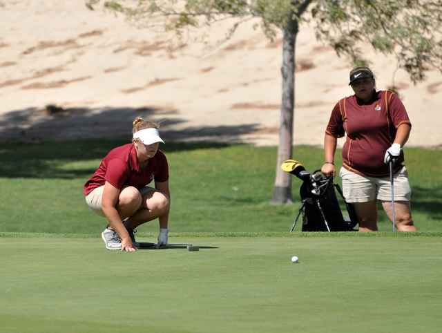 Horace Langford Jr. / Pahrump Valley Times Junior Desirae Hembree lines up her putt at Mountain Falls on Thursday. Hembree carded a 122.