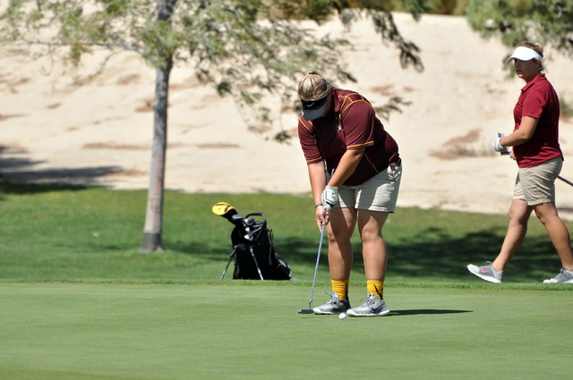 Horace Langford Jr. / Pahrump Valley Times Junior Jordan Egan putts on Thursday on the front nine at Mountain Falls. Trojans coach Bob Hopkins hopes to have his girls improve their short games by  ...