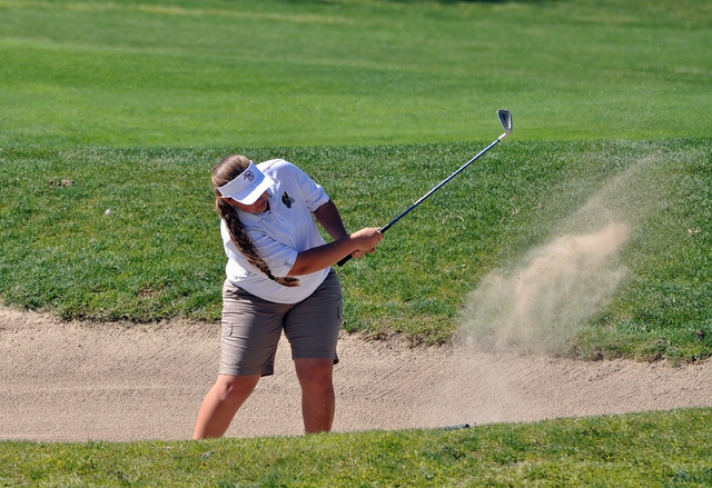 Horace Langford Jr. / Pahrump Valley Times  There's nothing like being stuck in a Mountain Falls bunker. Krista Toomer whacks her way out of a bunker on the seventh hole at Mountain Falls on Wed ...