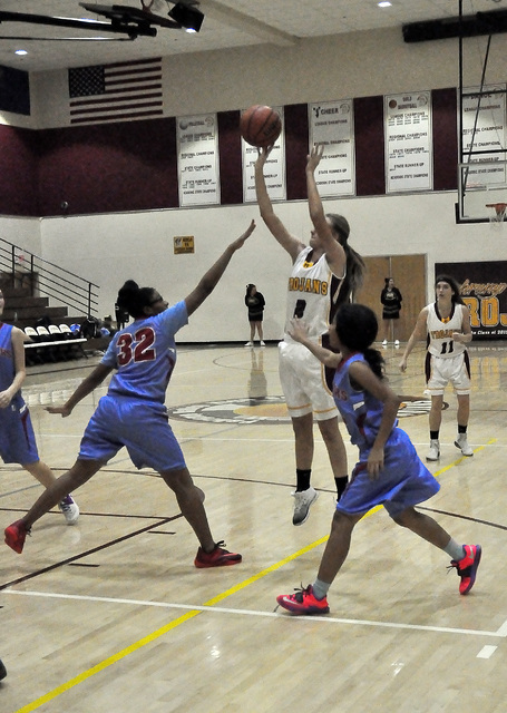 Horace Langford Jr. / Pahrump Valley Times  Alyvia Briscoe goes for the jumper against Western on Tuesday night. Briscoe set up the Trojans for a chance to steal the game away from the Warriors by ...