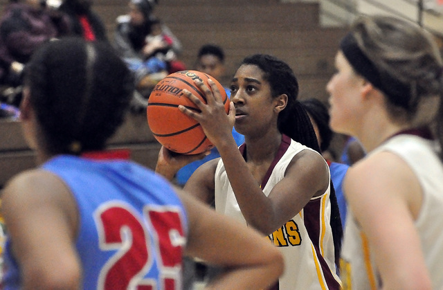 Horace Langford Jr. / Pahrump Valley Times   C'mone Wray-Ball seen here concentrating on a free throw. She played a crucial role in getting the Trojans within in striking distance by sinking 5 fre ...