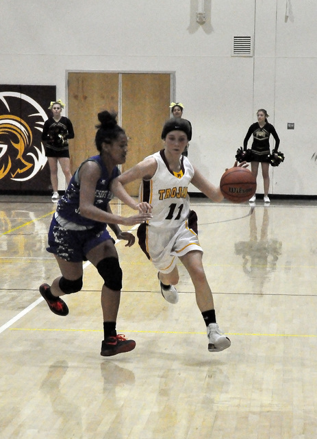 Bethany Calvert drives the ball down the court, looking for someone to pass to. The Trojans lost to Desert Pines 41-25. Horace Langford Jr. / Pahrump Valley Times