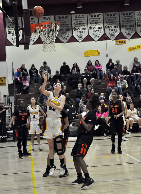 Jill Smith sinks a basket for Pahrump against Mojave on Monday. She led the team in scoring with 14 points. The win over Mojave secured Pahrump's first playoff berth since 2008.  Horace Langford ...