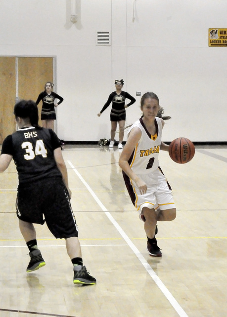 Trojans guard Alyvia Briscoe takes the ball down court against the Bengals last Monday. The Trojans won this game 47-17.  Horace Langford Jr. / Pahrump Valley Times