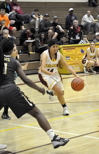Madeline Pereira-Villafuente looks for a lane in the Bonanza defense on Dec. 12. Horace Langford Jr. / Pahrump Valley Times