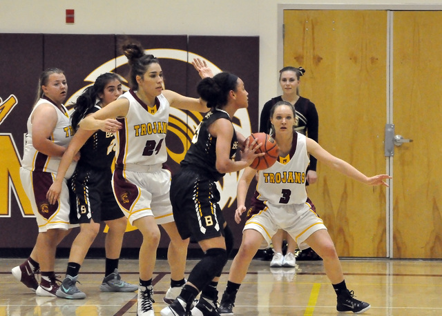 Horace Langford Jr. / Pahrump Valley Times   Helen Vann (24) and Jackie Stobbe (3) seal off the basket from Bonanza. The Trojans defense allowed only 5 points in the first half and was the main re ...