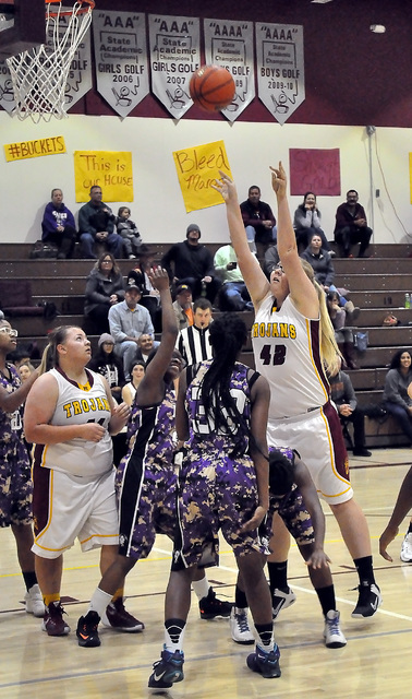 Caeli Havel (42) shot 100 percent on Tuesday night. She is seen making one of her three baskets against Sunrise Mountain in the Trojans 56-18 trouncing of the Miners as Jordan Egan looks on. Horac ...