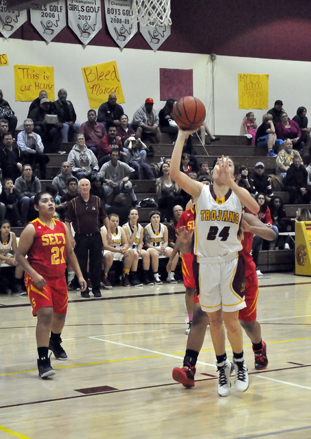 Horace Langford Jr. / Pahrump Valley Times  Helen Vann goes for a shot against a strong Tech defense. Vann had five points in Boulder City on Wednesday in the team's 27-26 victory.