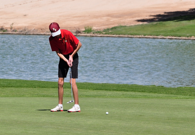 Horace Langford Jr / Pahrump Valley Times  Former Trojans golfer Derek Moore putting conventionally on the green at Mountain Falls. Anchored putting was only used the by 15 percent of the golfers.