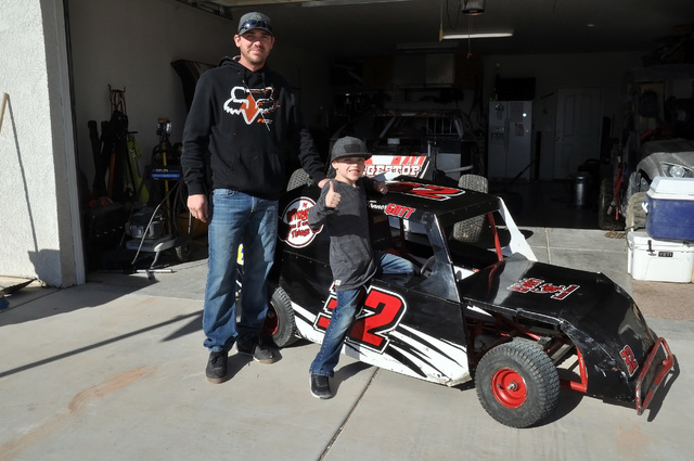 Horace Langford Jr. / Pahrump Valley Times   Father and son champions, Beau Gott (Left) and his son Tanner Gott stand next to the Mini Dwarf Car that the son drove this season. Tanner Gott took th ...