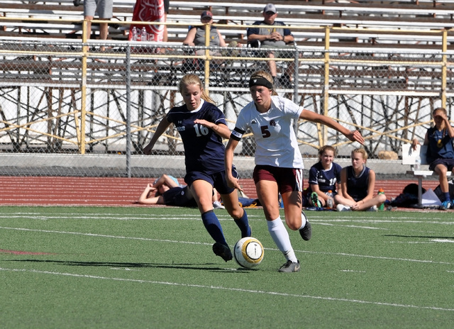 Horace Langford Jr./Pahrump Valley Times  Sydney Dennis takes the ball in to scoring territory before she scores her first goal of the game against Boulder City on Wednesday.