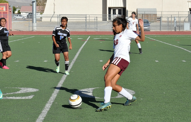 Horace Langford Jr. / Pahrump Valley Times  Donna Forcht, a Trojans defender passes the ball forward against the Jaguars on Tuesday.