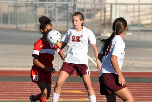 Trojans sophomore Grace Gundacker fights for the ball with a Western player on Wednesday.  Horace Langford Jr. / Pahrump Valley Times