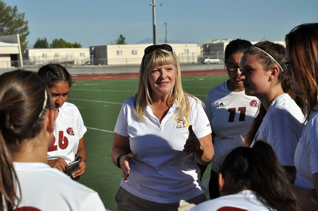 Trojans coach Julie Carrington directs her team at the half during the Boulder City game Sept. 14. The NIAA forfeited all of the Trojans games this week and disqualified the team from the playoffs ...