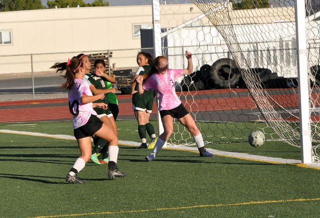 Horace Langford Jr. / Pahrump Valley Times Kaitlyn Carrington taps one in for a score against the Rattlers on Monday. It was one of three she had on the day.