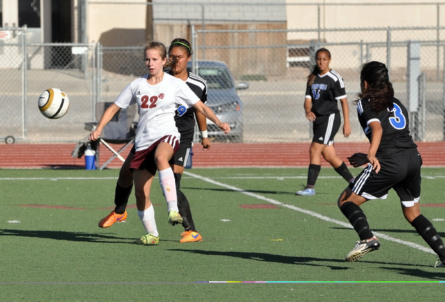 Horace Langford Jr. / Pahrump Valley Times    Grace Gundacker passes the ball to a teammate on Tueaday against Desert Pines.