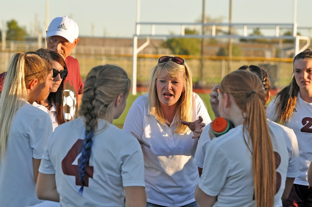 Trojans girls soccer coach Julie Carrington in happier times with her team. The NIAA issued an order yesterday afternoon that forced the Trojans to forfeit their entire season.  Horace Langford Jr ...