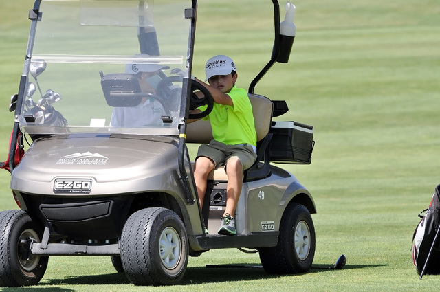 Horace Langford Jr / Pahrump Valley Times  Carter Nygaard taking the golf cart at Mountain Falls for a spin.