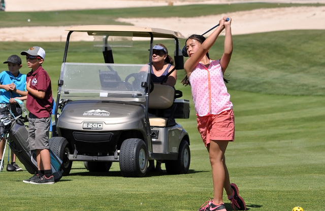 Horace Langford Jr / Pahrump Valley Times  Shania Hopkons drives the ball on hole one at Mountain Falls Golf Course on Monday.
