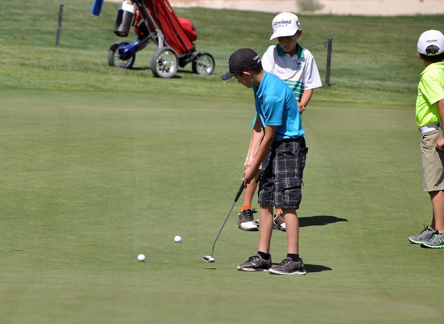 Horace Langford Jr / Pahrump Valley Times  Joey Mules pauses to reflect on a putt on the first hole. Around 12 golfers took part in the junior golf tournament on Monday at Mountain Falls.