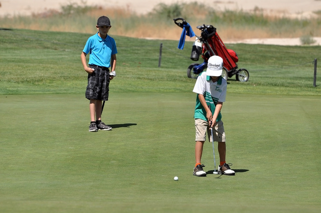 Horace Langford Jr / Pahrump Valley Times  Cameron Briscoe putting at Mountain Falls Golf Course during a junior golf tournament on Monday.