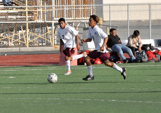 Horace Langford Jr. / Pahrump Valley Times Damien Shaw and Brian Mata race down the field for the JV boys soccer team during the Western game.