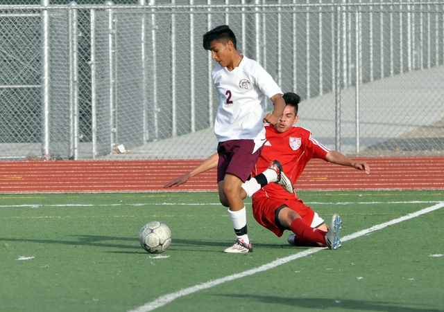 Horace Langford Jr. / Pahrump Valley Times  Alvaro Garcia of the Trojans JV team with the ball against Western.