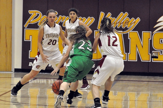 Jenna Broderick tries to keep Virgin Valley out of the key in the JV game on Dec. 29. Horace Langford Jr. / Pahrump Valley Times