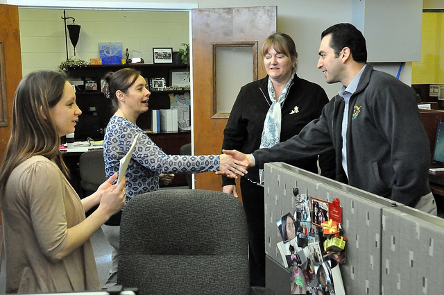 Ruben Kihuen, Nevada's 4th Congressional District Representative shakes hands with an employee during his tour of NyE Communities Coalition on Friday. The stop marked Kihuen's first visit to P ...